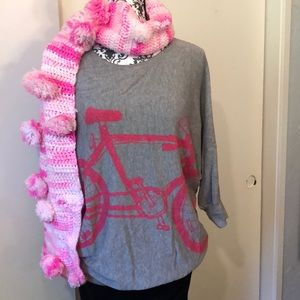 Sweater with pink bicycle on it